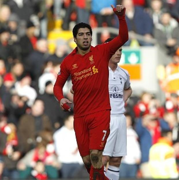 Luis Suarez celebrates netting Liverpool's opening goal in his pivotal performance at Anfield