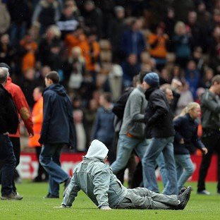 Wolves fans on the pitch after a Championship match at Molineux