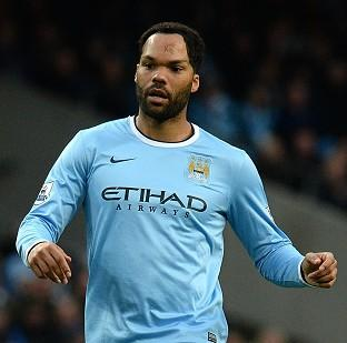 Blackpool Citizen: Manuel Pellegrini believes Joleon Lescott, pictured, still has a role to play for Man City