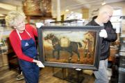 On the move: Museum curator Carol Davies and volunteer Tony Riley with the painting 'The Bell Mare'