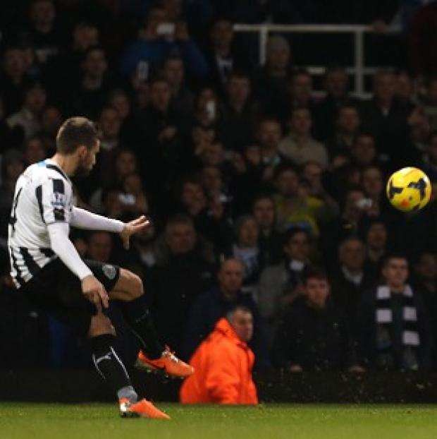 Blackpool Citizen: Yohan Cabaye, left, curls in his second of the game to secure victory for Newcastle