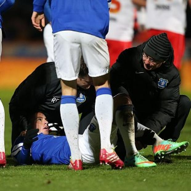 Blackpool Citizen: Bryan Oviedo lies injured after the tackle