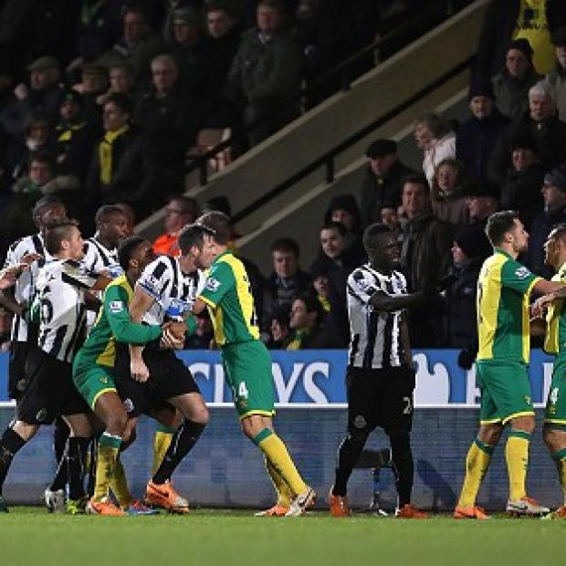 Blackpool Citizen: Norwich City's Bradley Johnson, right, saw red against Newcastle