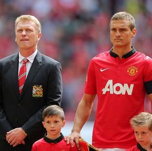 Blackpool Citizen: David Moyes, left, reveals the decision for Nemanja Vidic, right, to leave the club was a mutual decision