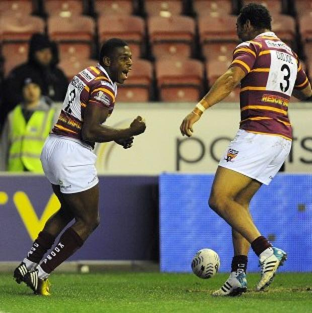 Blackpool Citizen: Jermaine McGillvary, left, scored a hat-trick in the win over Wigan