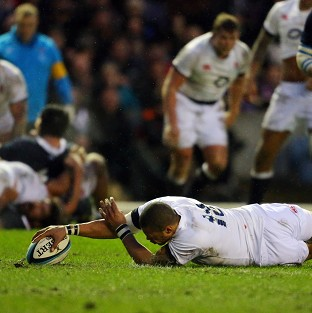 Luther Burrell scores England's opening try in their Calcutta Cup win over Scotland