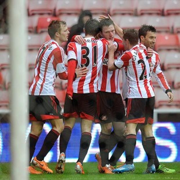 Blackpool Citizen: Craig Gardner, centre, is congratulated by his Sunderland team-mates after scoring