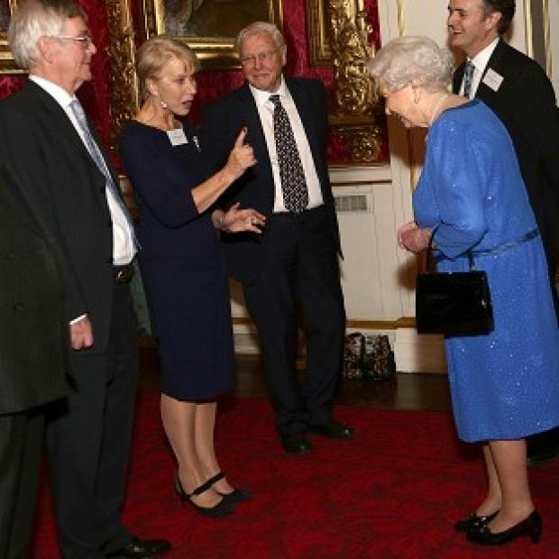 Blackpool Citizen: Queen Elizabeth II (right) meeting Dame Helen Mirren, as Sir David Attenborough (third left) looks on, during a Reception for the Dramatic Arts, at Buckingham Palace, London.