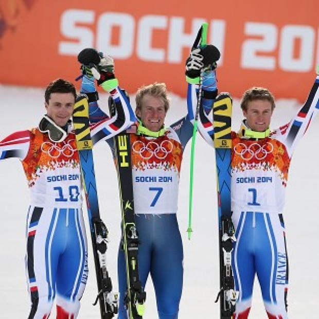 Blackpool Citizen: Ted Ligety, centre, celebrates his gold (AP)