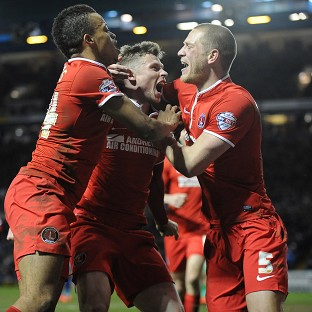 Simon Church, centre, celebrates scoring the winning goal