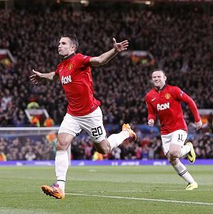 Blackpool Citizen: Manchester United's Robin van Persie (left) celebrates completing his hat-trick