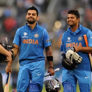 Blackpool Citizen: Virat Kohli, left, and Suresh Raina helped India on their way to victory over arch-rivals Pakistan