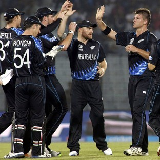Brendon McCullum, centre, celebrates with his team-mates during New Zealand's World T20 game with England (AP)