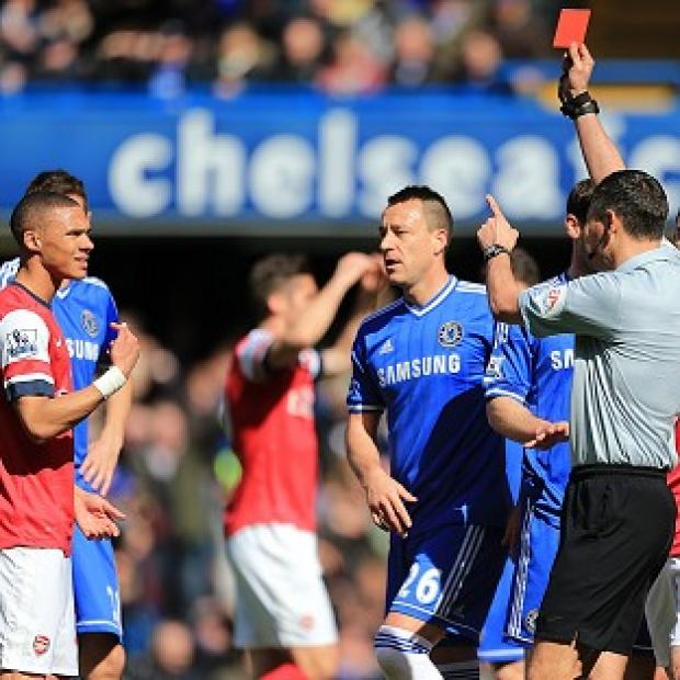 Blackpool Citizen: Andre Marriner, right, mistakenly sent off Kieran Gibbs, left, during Arsenal's 6-0 defeat to Chelsea on Saturday
