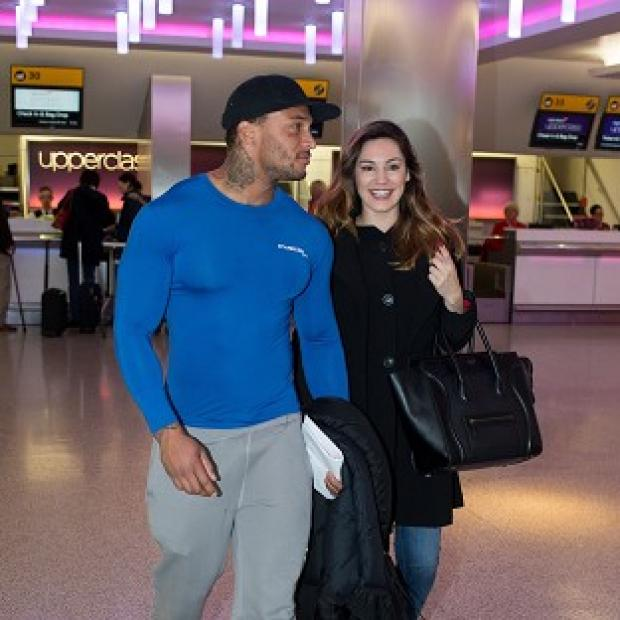 Blackpool Citizen: Kelly Brook with her reported fiance David McIntosh at Heathrow Airport