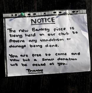Blackpool Citizen: A notice sits where the latest officially confirmed Banksy artwork was, on Clements Street in Bristol