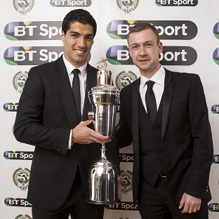 Luis Suarez, left, won the Professional Footballers' Association's Player of the Year award on Sunday