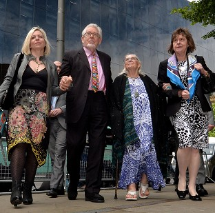 Rolf Harris arrives with daughter Bindi (left), wife Alwen and niece Jenny (right) at Southwark Crown Court