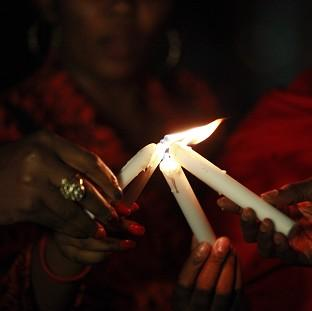 Blackpool Citizen: People light candles during a vigil in Abuja to mark one month after the Nigerian schoolgirls were kidnapped (AP)