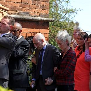 Judy Murray with Nino Severino follows the coffin of former