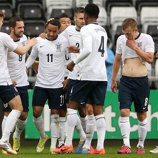 England Under-21 players celebrate the first of Nathan Redmond's three goals against Wales