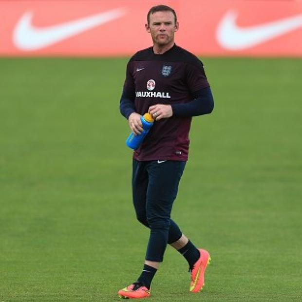 Blackpool Citizen: Wayne Rooney knows the pressure is on for him to deliver at the upcoming World Cup