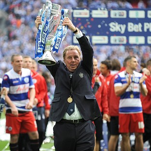 Harry Redknapp lifts the trophy