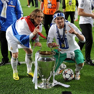 Gareth Bale, right, helped Real Madrid to their 10th European Cup