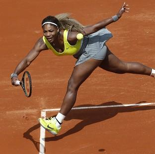 Serena Williams eased to a 6-2 6-1 victory over Alize Lim in Paris (AP)