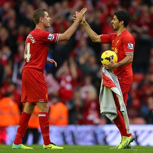 Jordan Henderson, left, believes Luis Suarez, right, will be fit to face England