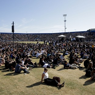 The crowd listens during a memorial service for the victims and families of Friday's rampage at Harder Stadium on the campus of University of California, Santa Barbara