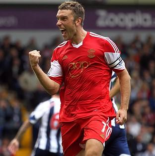 Rickie Lambert hopes to accomplish a boyhood dream of scoring for Liverpool in front of the Kop