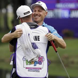 Ben Crane hugs his caddie after winning the St Jude Classic in Memphis (AP)