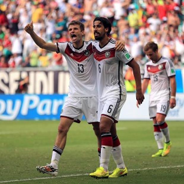 Blackpool Citizen: Thomas Muller, left, continued his impressive record in the World Cup finals