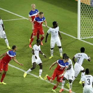 John Brooks, second left, heads in his side's winner (AP)