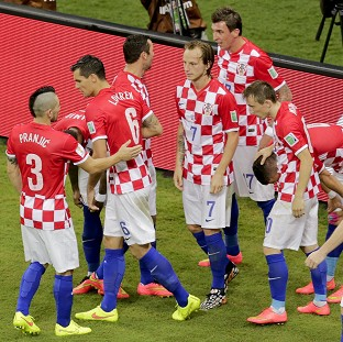 Croatia celebrate scoring against Cameroon (AP)