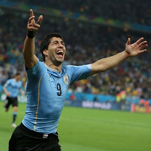 Luis Suarez scored twice to give Uruguay a 2-1 win over England