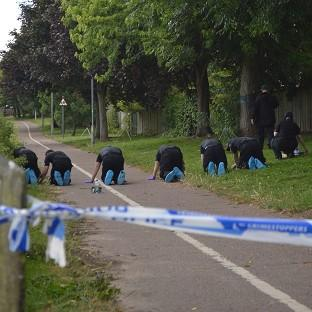 Blackpool Citizen: Police search the scene at Salary Brook Trail in Colchester