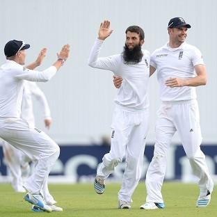 Moeen Ali, centre, celebrates taking the wicket of Sri Lanka's Lahiru Thirimanne
