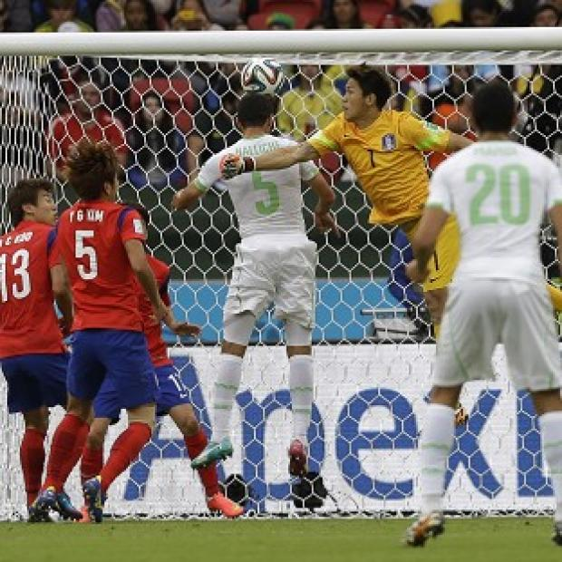 Blackpool Citizen: Rafik Halliche, centre, scores Algeria's second goal in the 4-2 win over South Korea. (AP)