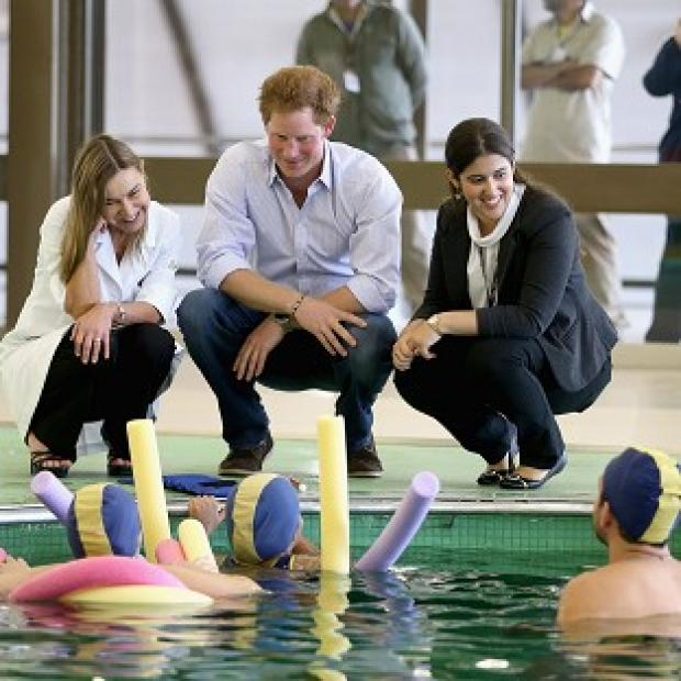 Blackpool Citizen: Prince Harry meets patients in the Rede Sarah Hospital for Nerological Rehabilitation injuries during his visit to the hospital in Brasilia