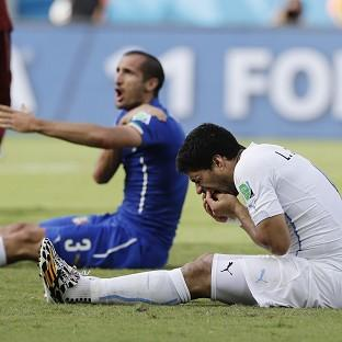 Italy's Giorgio Chiellini accused Luis Suarez of biting him during the contest (AP)