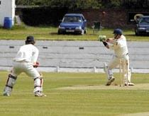 Blackpool Citizen: orecambe's Gareth Peddler is clean bowled out by Blackpool's Richard Gleeson as wicketkeeper James Smith looks on