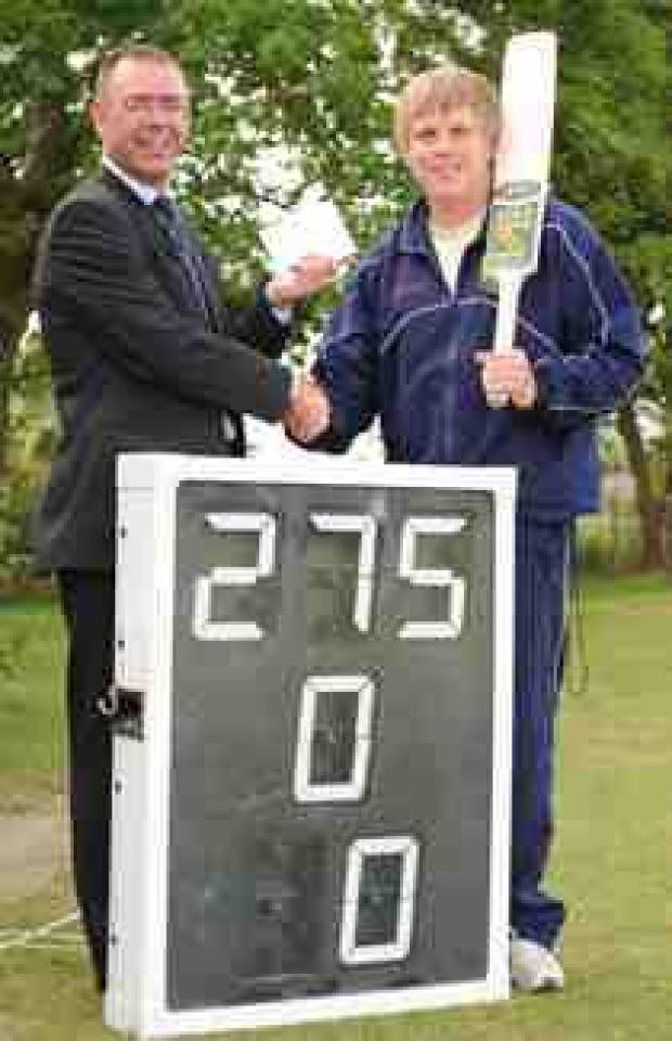 Blackpool Citizen: From left: Moore and Smalley's tax manager and Great Eccleston CC's club secretary, David Walker, presenting James Thistlethwaite with his prize