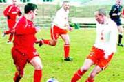 TUSSLE: Darwen, in all red, challenge for possession